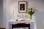 Brussels Belgium 6th December 2013. At the South African Embassy in Brussels people gather. Nelson Mandela died just yesterday.They can sign a book at this table with picture flower and candle.