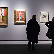 "BRESCIA, ITALY - FEBRUARY 11: Visitors admire paintings and drawings from the Odalisques serie by Matisse at the  Santa Giulia Museum on February 11, 2011 in Brescia, Italy. The exhibition ""Matisse La Seduzione di Michelangelo"" shows  180 works of the French artist and will stay open until June 12th 2011"