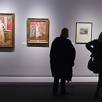 """BRESCIA, ITALY - FEBRUARY 11: Visitors admire paintings and drawings from the Odalisques serie by Matisse at the  Santa Giulia Museum on February 11, 2011 in Brescia, Italy. The exhibition """"Matisse La Seduzione di Michelangelo"""" shows  180 works of the French artist and will stay open until June 12th 2011"""