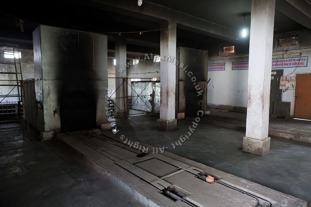Furnaces of the recently-constructed electric crematorium are photographed in Agra. Most people still prefer the traditional practice of using wood.