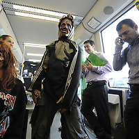 "Actors dressed up like zombies travel in tram, on September 2, 2010, in the Northern Spanish city of Bilbao. Actors and dancers, dressed up like zombies, visited Bilbao to promote the musical show ""Forever, King of Pop"", based on Michael Jackson's ""Thriller"".  PHOTO/Rafa Rivas"