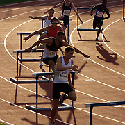 Athletes approach the first hurdle during the Men's 400m Hurdles event won by Tristan Thomas of Australia from Bershawn Jackson, USA,  at the Sydney Track Classic 2009 held at Sydney Olympic Park Athletics Centre, Sydney, Australia on February 28, 2009.  Photo Tim Clayton