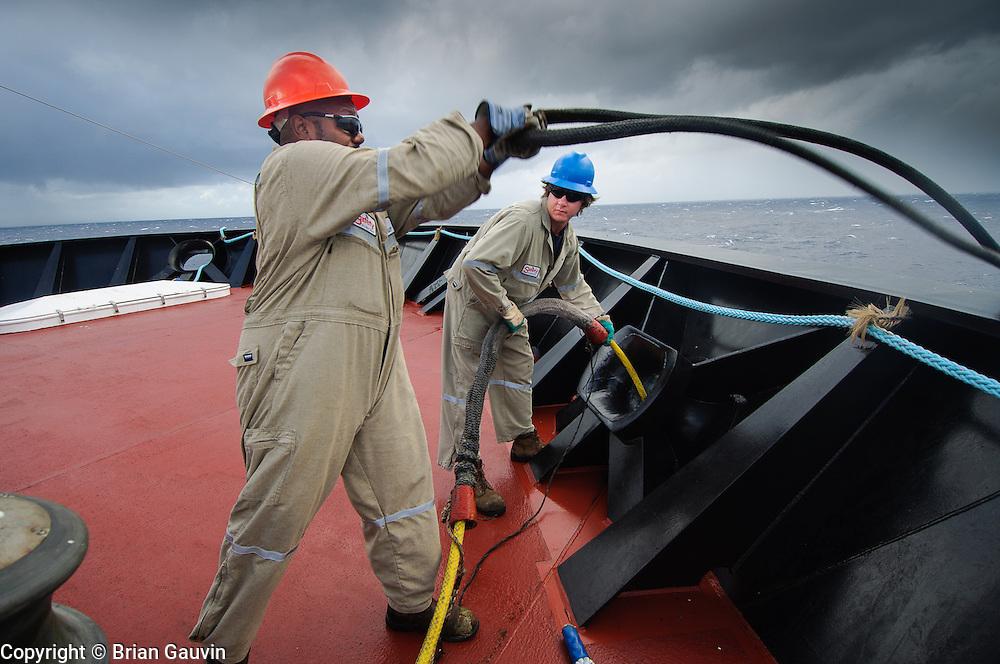 Utility man, Orvin McCoy and AB, William Stubbs setting up the mooring lines.  ATB, Legacy and barge 750-1, Crowley Maritime. Transporting primium and regular grade gasoline from Marathon Oil in Garryville, La. to Port Everglades and Tampa Florida.