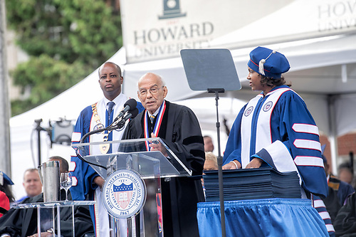 An honoree speaking onstage at Commencement.