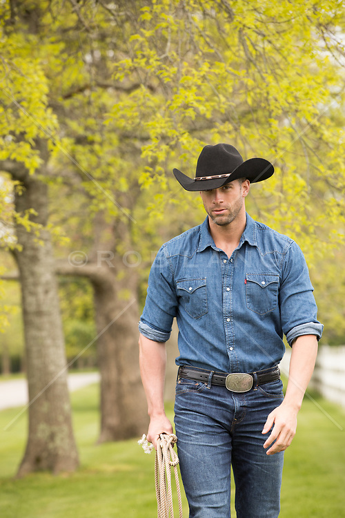 rugged good looking cowboy on a ranch