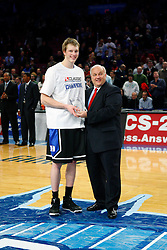 Nov 21, 2008; New York, NY, USA; Duke Blue Devils forward Kyle Singler (12) receives an award for player of the tournament after the 2K Sports Classic Championship game at Madison Square Garden. Duke beat the Michigan Wolverines 71-56.