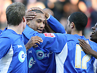 Zebroski for Millwall celebrates his goal with the rest of the team