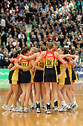 The Magic celebrate victory after the National Bank Cup semi final netball match between the Southern Sting and the Waikato Magic at Stadium Southland, Invercargill on Friday 16 June 2006. The Magic won the match 61-51. Photo: Andrew MacKay/PHOTOSPORT<br /> <br /> 160606 hug hugging huddle