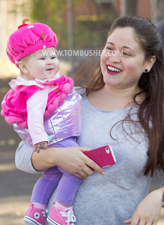 Middletown, New York  - A woman holds a child wearing a costume duringthe Halloween Fall Festival at the Middletown YMCA's Center for Youth Programs on Oct. 25, 2014.