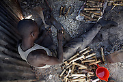 A man cuts cow bones at the Kibera workshops in Nairobi, Kenya, on Tuesday, Jan. 13, 2008. The bone will be cut and sculpted into various shapes for use in fashion items. Kibera is the largest slum in Africa, home to 1 million people many of whom live in abject poverty. MAX&Co. and the ITC (International Trade Centre) employ 100 people here to produce the bone disks that adorn their African range of products.
