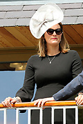 Elegant lady wearing a fashionable hat during the third day of the Dante Festival at York Racecourse, York, United Kingdom on 17 May 2019.