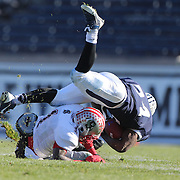 Kahlil Keys, Yale, is tackled by Emory Polley, Brown, during the Yale V Brown, Ivy League Football match at Yale Bowl. Yale won the match 24-17. New Haven, Connecticut, USA. 9th November 2013. Photo Tim Clayton