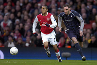 Photo: Olly Greenwood.<br />Arsenal v Bolton Wanderers. The FA Cup. 28/01/2007. Arsenal's Gael Clichy and Bolton's Nicky HUnt
