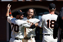 SAN FRANCISCO, CA - MAY 25: Brandon Crawford #35 of the San Francisco Giants is congratulated by George Kontos #70 and Matt Cain #18 after hitting a walk off RBI single against the San Diego Padres during the tenth inning at AT&T Park on May 25, 2016 in San Francisco, California. The San Francisco Giants defeated the San Diego Padres 4-3 in 10 innings. (Photo by Jason O. Watson/Getty Images) *** Local Caption *** Brandon Crawford; George Kontos; Matt Cain