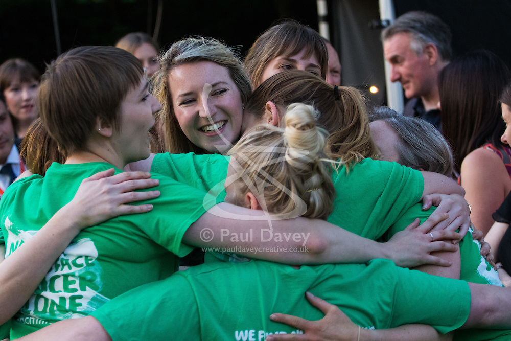 Members of the victorious McMillans team emrace after their 2-0 defeat of the female MPs as teams from uk industry as well as the House of Commons and the House of Lords compete in the annual McMillan Cancer Charity tug o' war.