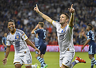 Oct 25, 2015; Kansas City, KS, USA; LA Galaxy forward Robbie Keane (7) reacts after scoring a goal against Sporting KC during the first half at Sporting Park. Mandatory Credit: Peter G. Aiken-USA TODAY Sports