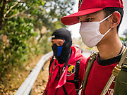 "06 APRIL 2013 - CHIANG MAI, CHIANG MAI, THAILAND: A Thai fire commander coordinates efforts to control an illegal burn that got out of control on the edge of Chiang Mai. The ""burning season,"" which roughly goes from late February to late April, is when farmers in northern Thailand burn the dead grass and last year's stubble out of their fields. The burning creates clouds of smoke that causes breathing problems, reduces visibility and contributes to global warming. The Thai government has banned the burning and is making an effort to control it, but the farmers think it replenishes their soil (they use the ash as fertilizer) and it's cheaper than ploughing the weeds under.   PHOTO BY JACK KURTZ"