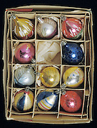 box filled with Christmas ornaments with one ball missing