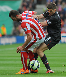 Liverpool's Steven Gerrard battles with Stoke City's Erik Pieters for the ball- Photo mandatory by-line: Nizaam Jones/JMP - Mobile: 07966 386802 - 24/05/2015 - SPORT - Football - Stoke - Britannia Stadium - Stoke City v Liverpool - Barclays Premier League