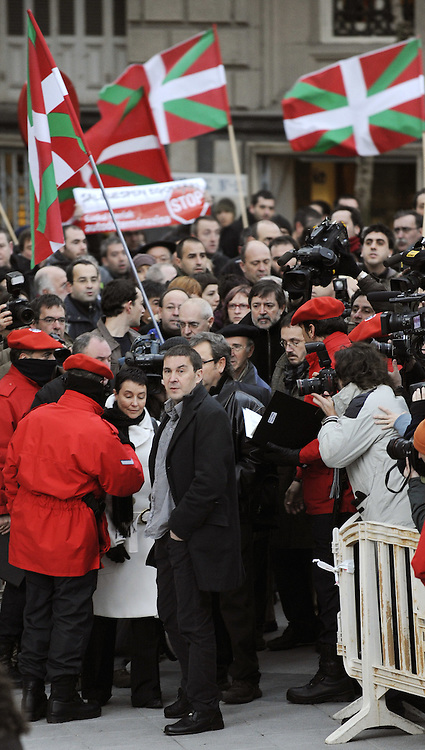 The leader of the banned Basque party Batasuna, Arnaldo Otegi (C), arrives with his lawyer Jone Goirizelaia (3L) to take part in his trial, on January 8, 2009, in the northern Spanish Basque city of Bilbao. The Basque regional president Juan Jose Ibarretxe, leader of Basque Socialist Party-PSE-PSOE Patxi Lopez and PSE member Rodolfo Ares are charged with meeting Otegi and other representatives of the banned political wing of the armed separatist group ETA, Batasuna. Neither is expected to be convicted as prosecutors have recommended that the charges be dropped.