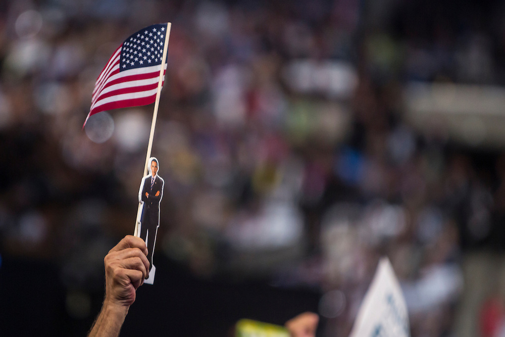 An audience member waves a cutout of President Barack Obama as former President Bill Clinton speaks at the Democratic National Convention on Wednesday, September 5, 2012 in Charlotte, NC.
