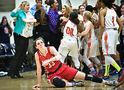 Mater Dei senior Katie Lou Samuelson lifts herself up after falling as Chaminade celebrates their victory over Mater Dei during the CIF-SS Open Division finals game at Azusa Pacific. Mater Dei lost 64-63.<br /> ///ADDITIONAL INFORMATION: hsghoop.open.0308 &ndash; 3/7/15 &ndash; NICK AGRO, ORANGE COUNTY REGISTER-BACKGROUND:<br /> HS girls basketball championship game: Mater Dei vs. Chaminade of West<br /> Hills in the finals of the CIF-SS Open Division playoffs. Need game action<br /> of Mater Dei players for print and web.