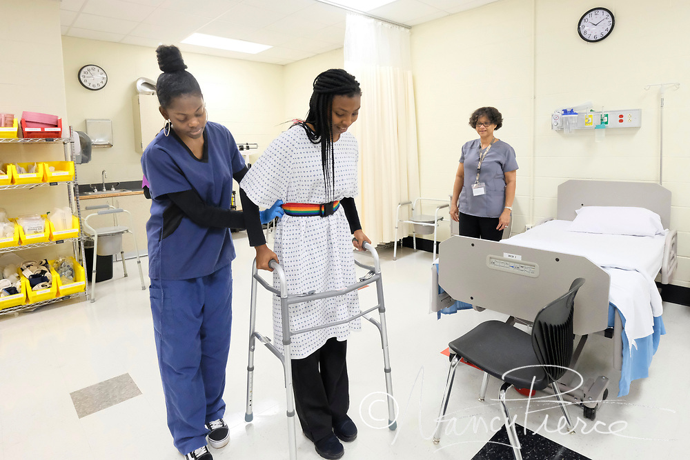 Students at Hawthorne Academy of Health Sciences learned the skills necessary for them to take and pass the Certified Nursing Assistant exam, a prerequisite for nursing school. Here: assisting a patient to use a walker.