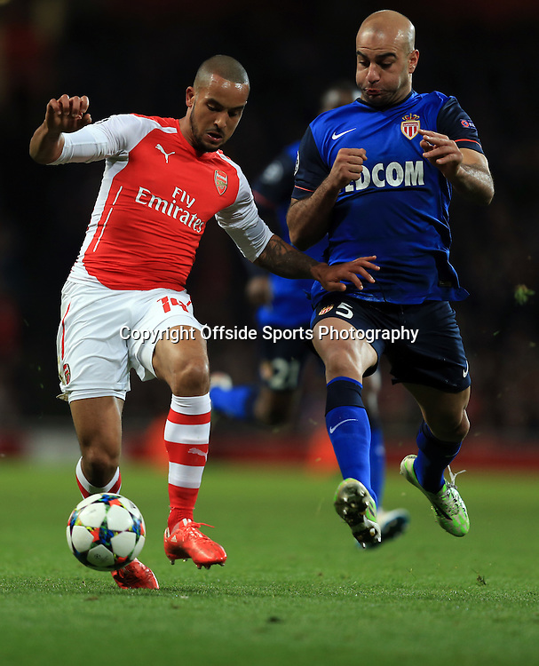 25 February 2015 - UEFA Champions League - Last 16 (1st Leg) - Arsenal v AS Monaco - Theo Walcott of Arsenal tangles with Aymen Abdennour of AS Monaco - Photo: Marc Atkins / Offside.