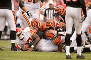 KANSAS CITY, MO - SEPTEMBER 10:  Running back Larry Johnson #37 of the Kansas City Chiefs is tackled by a group of defensive players during a game against the Cincinnati Bengals on September 10, 2006 at Arrowhead Stadium in Kansas City, Missouri.  The Bengals won 23 to 10.  (Photo by Wesley Hitt/Getty Images)***Local Caption***Larry Johnson