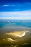 """Nederland, Zeeland, Gemeente Schouwen-Duiveland, 01-04-2016; Oosterschelde met zandplaat Neeltje Jans, Oosterscheldekering en werkeiland Neeltje Jans in de achtergrond. De zandplaten in de Oosterschelde worden kleiner ten gevolge van 'zandhonger', een gevolg van de veranderde waterhuishouding ten gevolg van de aanleg van de stormvloedkering.<br /> Eastern Scheldt with sand bank Neeltje Jans, Oosterscheldekering and work island Neeltje Jans in the background. The sandbanks of the Oosterschelde become smaller due to """"sand starvation"""", a result of the changed water balance as a result of the construction of the storm surge barrier.<br /> luchtfoto (toeslag op standard tarieven);<br /> aerial photo (additional fee required);<br /> copyright foto/photo Siebe Swart"""