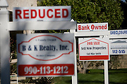 Real Estate Signs at Foreclosed Property