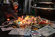 A woman lays a candle at a small shrine constraucted where people gather in silent vigil to honour hostages, Kenji Goto and Haruna Yukawa, who were murdered by ISIS terrorists in Syria in January. Shibuya, Tokyo, Japan Sunday February 8h 2015. Over 100 people gathered in Shibuya's famous Hachiko square at 5pm to hold a silent prayer vigil for the Japanese hostages and Jordan pilot. The vigil ended at 7:30pm with a small candle-lit shrine. Friends of the hostages were in the vigil and promised that all flowers and messages would be delivered to relatives.