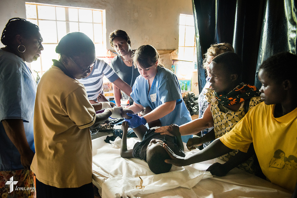 Dr. Katie Butler, a critical care surgeon from Boxford, Mass., attending Our Savior Lutheran Church in Topsfield, Mass., treats a boy with a hip dislocation during the Mercy Medical Team clinic Friday, June 13, 2014, at the Luanda Doho Primary School in Kakmega County, Kenya. LCMS Communications/Erik M. Lunsford