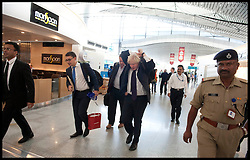 London Mayor Boris Johnson outs on his rucksack while walking through Hyderabad airport on the way to Mumbai, on the forth day of a six-day tour of India, where he will be trying to persuade Indian businesses to invest in London, Wednesday November 28, 2012. Photo by Andrew Parsons / i-Images