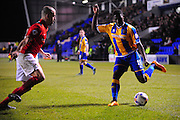 Sullay Kaikai of Shrewsbury Town (on loan from Crystal Palace) takes on Joe Cole of Coventry City FC during the Sky Bet League 1 match between Shrewsbury Town and Coventry City at Greenhous Meadow, Shrewsbury, England on 8 March 2016. Photo by Mike Sheridan.
