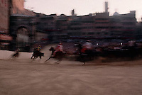 August 1997, Siena, Italy --- Horses Racing in the Palio --- Image by © Owen Franken/CORBIS