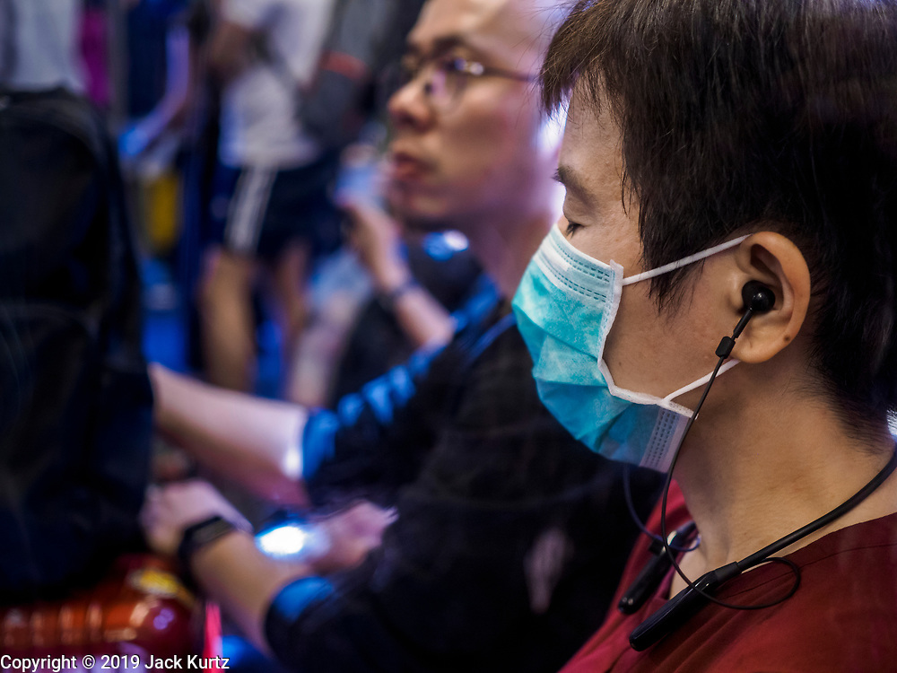 "14 JANUARY 2019 - BANGKOK, THAILAND:    A passenger wearing a dust filter on the skytrain in Bangkok. Bangkok has been blanketed by heavily polluted air for almost a week. Monday morning, the AQI (Air Quality Index) for Bangkok  was 182, higher than New Delhi, Jakarta, or Beijing. The Saphan Kwai neighborhood of Bangkok recorded an AQI of 370 and the Lat Yao neighborhood recorded an AQI of 403. An AQI above 50 is considered unsafe. Public health officials have warned people to avoid ""unnecessary"" outdoor activities and wear breathing masks to filter out the dust.      PHOTO BY JACK KURTZ"