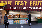 Brooklyn, NY - 27 March 2020. Restrictions on the public during the COVID-19 pandemic have led to store closures throughout Brooklyn's neighborhoods. The New Best Fruit and Vegetable store on Flatbush Avenue has closed its doors and rolled down its shutters, leaving the bins that normally display its wares empty and abandoned.