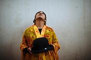 Sarita, alias &ldquo;The Romantic&rdquo;, dresses a traditional of Aymara people formed by a embroidered shawl, a pollera (a baggy skirt), and a bombin (a traditional bowler hat), to participate in the wrestling show in El Alto, Bolivia, February 26, 2012. <br /> SPANISH: Sarita &ldquo;La Rom&aacute;ntica&rdquo; con su manta pollera y sombrero, vestimenta tradicional de Bolivia se prepara para su participaci&oacute;n en el espect&aacute;culo de lucha libre, en El Alto, Bolivia, el 26 de Febrero de 2012.