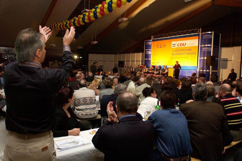 25 FEB 2004, DEMMIN/GERMANY:<br /> Angela Merkel, CDU Bundesvorsitzende, haelt eine Rede, Politischer Aschermittwoch der CDU Mecklenburg-Vorpommern, Tennis- und Squash Center Demmin<br /> IMAGE: 20040225-02-030<br /> KEYWORDS: speech, Zuhoerer, Zuh&ouml;rer, G&auml;ste, Gaeste