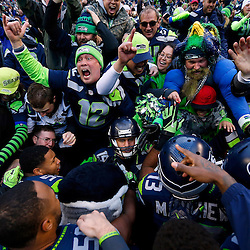 Seattle Seahawks wide receiver Jermaine Kearse (15) is surrounded by fans and teammates following his NFC Championship game-winning touchdown catch against the Green Bay Packers at CenturyLink Field.