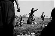 THE ANNUAL FOOTBALL GAME DESCENDS INTO ARGUMENT. ROMANIAN ORTHODOX EASTER CELEBRATIONS. SINTESTI, ROMANIA, EASTER 1995..©JEREMY SUTTON-HIBBERT 2000..TEL./FAX. +44-141-649-2912..TEL. +44-7831-138817.