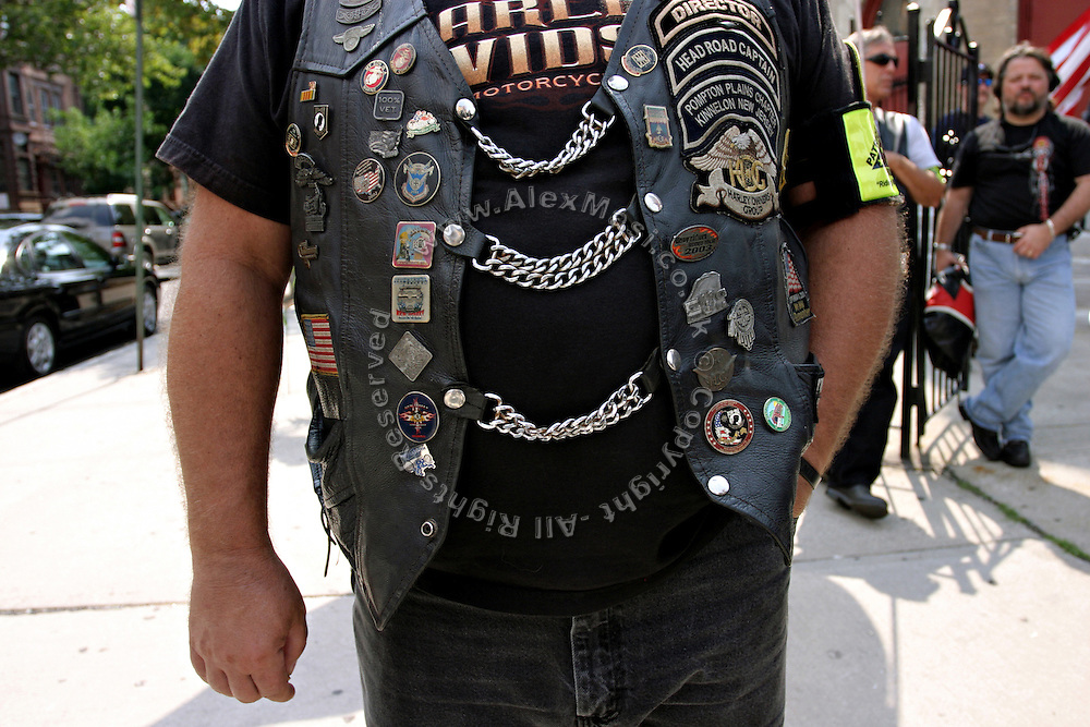 Detail of the leather jacket worn by a member of the Patriot Guard Riders standing in front of the Bedsford Central Presbyterian church, while awaiting the passage of LCpl. Nicholas J. Whyteís coffin, in Brooklyn, New York, NY., on Friday, June 30, 2006. LCpl. Nicholas J. Whyte, a 21-year-old American serviceman died  on June 21, 2006, while conducting combat operations in Al Anbar province, Iraq. The Patriot Guard Riders is a diverse amalgamation of riders from across the United States of America. Besides a passion for motorcycling, they all have in common an unwavering respect for those who risk their lives for the country's freedom and security. They are an American patriotic group, mainly but not only, composed by veterans from all over the United States. They work in unison, calling upon tens of different motorcycle groups, connected by an internet-based web where each of them can find out where and when a 'Mission' is called upon, and have the chance to take part. This way, the Patriot Guard Riders can cover the whole of the United States without having to ride from town to town but, by organising into different State Groups, each with its own State Captain, they are still able to maintain strictly firm guidelines, and to honour the same basic principles that moves the group from the its inception. The main aim of the Patriot Guard Riders is to attend the funeral services of fallen American servicemen, defined as 'Heroes' by the group,  as invited guests of the family. These so-called 'Missions' they undertake have two basic objectives in particular: to show their sincere respect for the US 'Fallen Heroes', their families, and their communities, and to shield the mourners from interruptions created by any group of protestors. Additionally the Patriot Guard Riders provide support to the veteran community and their families, in collaboration with the other veteran service organizations already working in the field.   **ITALY OUT**