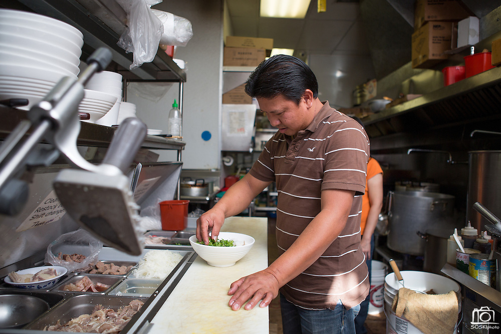 Owner Kevin Tran prepares a bowl of beef pho (#1) in the kitchen of Pho Saigon Noodle House in Milpitas, Calif., on Sept. 19, 2012.  Photo by Stan Olszewski/SOSKIphoto.
