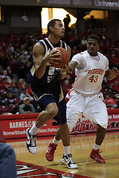 04 December 2010: Austin Hill forces a pass as he almost puts Erik Rush out of bounds during an NCAA basketball game between the Montana State Bobcats and the Illinois State Redbirds at Redbird Arena in Normal Illinois.