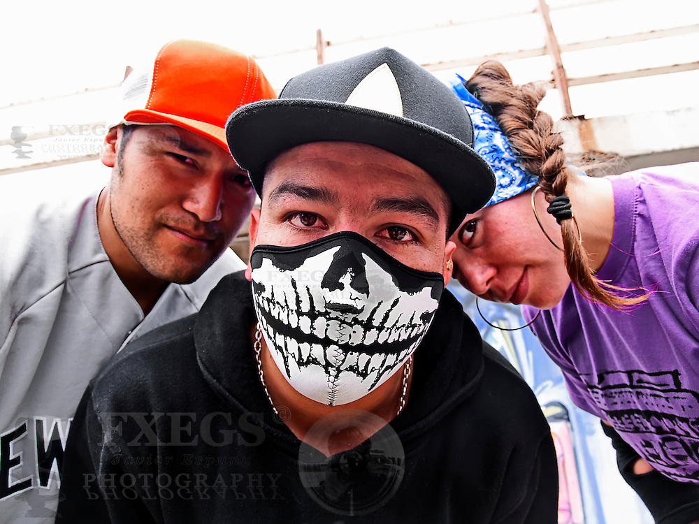 Hispanic rappers portrait at the street looking at viewer
