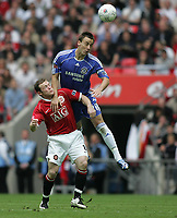 Photo: Lee Earle.<br /> Chelsea v Manchester United. The FA Cup Final. 19/05/2007.United's Wayne Rooney (L) battles with John Terry.