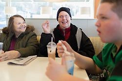 1/27/15 11:47:33 AM -- Louisa, KY, U.S.A  -- Cheryl Castle, center, sits at a table with her mother Alice Ratliff, left, and Nate, her son at McDonalds in Prestonsburg on Tuesday. Before the NeuroPace device was implanted into her skull Cheryl would not go into public places for the fear she would have a seizure. <br /> <br /> &quot;It feels nice to not have to worry about having a seizure.&quot; Cheryl said after sitting in the dining area at McDonalds for the first time since having the NueroPace device implanted. Usually they would eat in the car for her fear of having a public seizure was too high. <br /> <br /> She is a recent recipient of the high-tech device, can now do many tasks she was unable to do when her epileptic seizures became more severe and more frequent. Now she's getting back to a normal life.<br /> <br />  --    Photo by Jonathan Palmer, Freelance