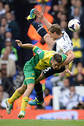Norwich's Ricky van Wolfswinkel and Tottenham's Jan Vertonghen compete for the ball  - Photo mandatory by-line: Mitchell Gunn/JMP - Tel: Mobile: 07966 386802 14/09/2013 - SPORT - FOOTBALL -  White Hart Lane - London - Tottenham Hotspur v Norwich - Barclays Premier League