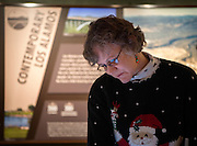 em122316f/jnorth/Heather McClenahan, executive director of the Los Alamos Historical Society, walks around the newly remodeled Los Alamos History Museum Friday December 23, 2016. The museum will open to the public on Dember 30.  (Eddie Moore/Albuquerque Journal)
